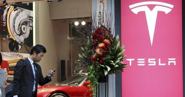 Tesla upbeat on Japan business, opens showroom