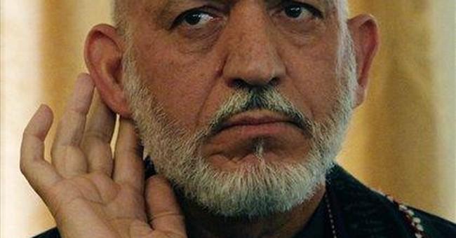 Afghan parliamentary loser blocks road in protest