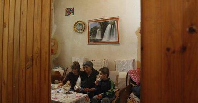 Bosnian refugees get donation after Jolie's visit