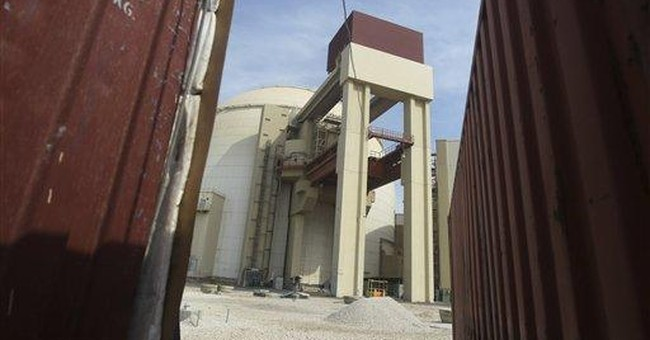 Iran loads fuel rods into 1st nuclear power plant