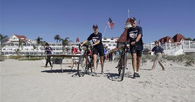 Couple bikes across US to aid CIA families