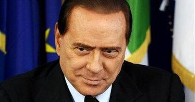 Berlusconi dismisses prostitute reports as 'trash'