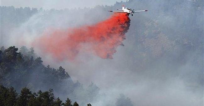 Authorities lift fire evacuations in Colorado