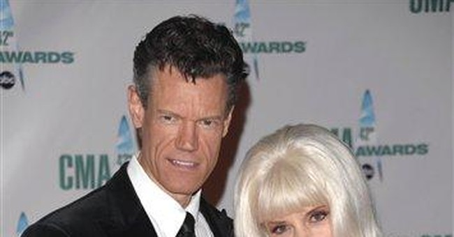 Randy Travis and wife-manager, Elizabeth, divorce