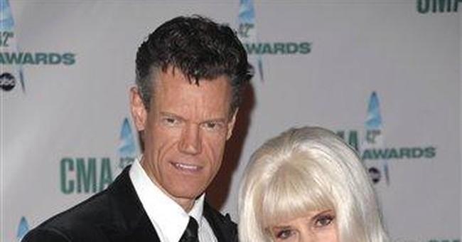 Randy Travis and wife-manager, Elizabeth, divorce