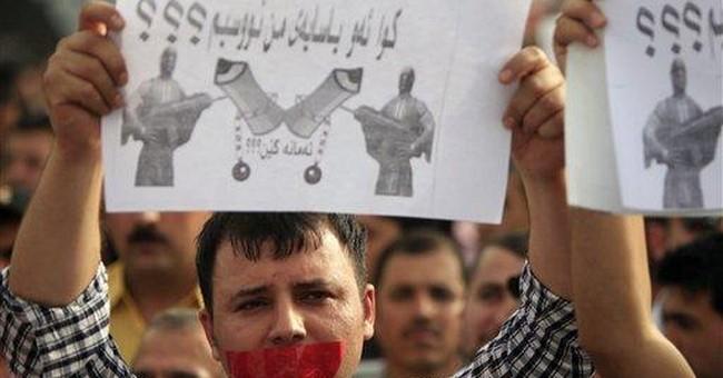 Suicide bomber kills 21 north of Baghdad