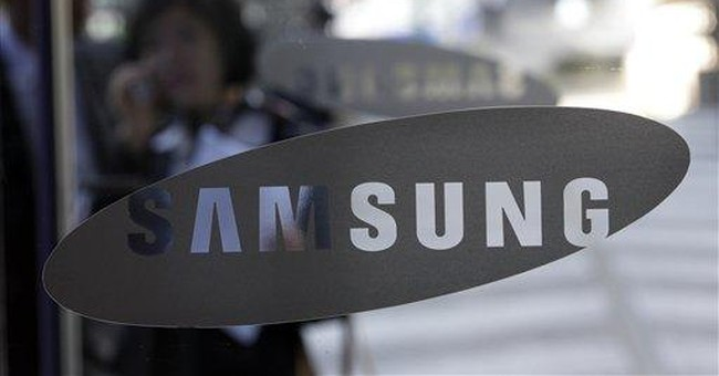 Samsung 3Q profit at record high but outlook mixed