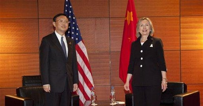 China assures Clinton on rare earth exports