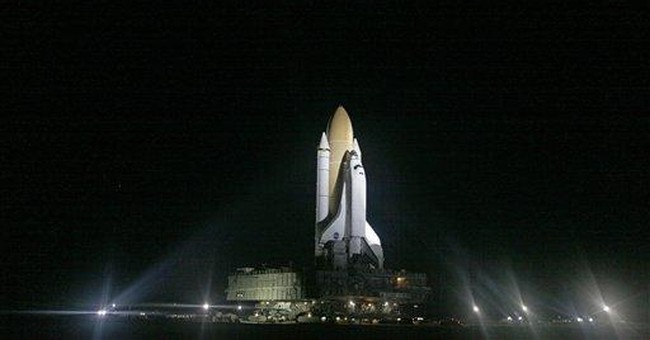 Shuttle leak repairs good, launch on for Wednesday