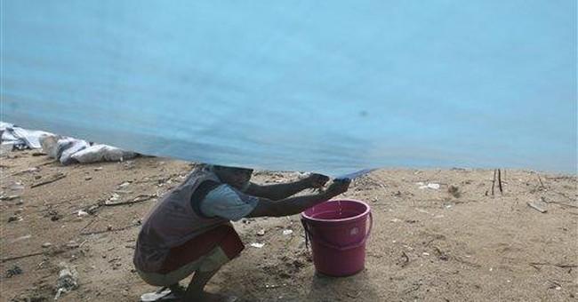 Returnees flee as Indonesia volcano spews more ash