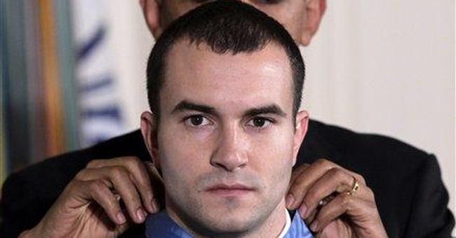 Soldier given highest medal for heroism on a ridge