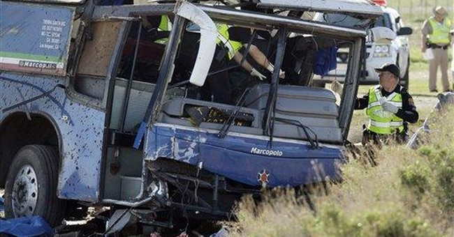 1 dead, 13 injured in western Pa. car-bus crash