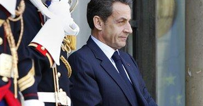 French leader, on world stage, disappoints at home