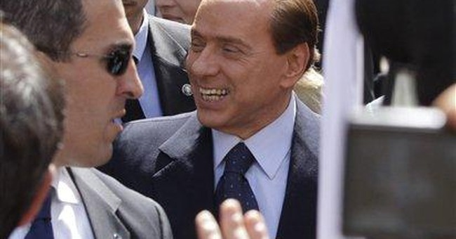 Berlusconi say's he'll live to 120, won't quit