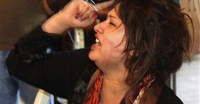 Libyan woman recounts gang rape by Gadhafi troops