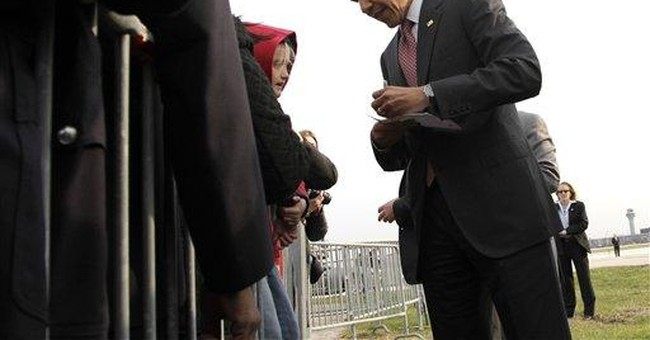 Obama visits his hometown to restart money chase