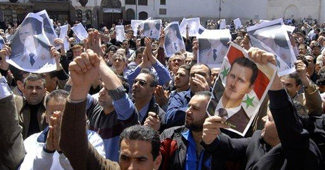Tear gas, batons thwart Syrian march on capital