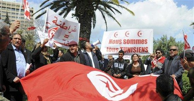 Tunisia's former ruling party members hold protest