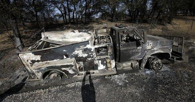 Some Texans return to homes charred by wildfires