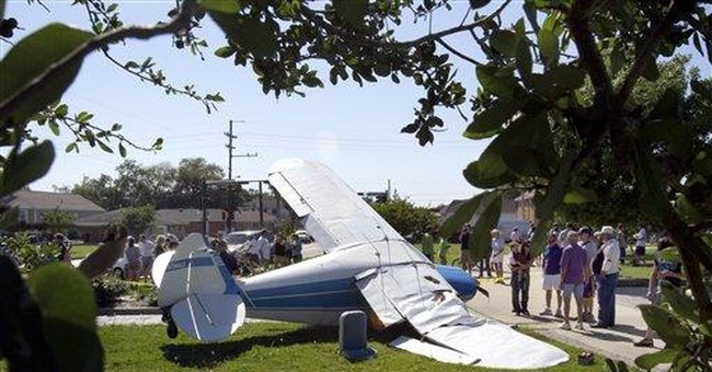 Plane lands on busy New Orleans road, strikes van