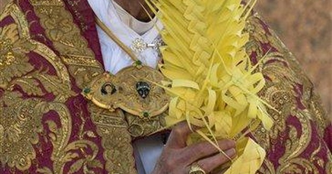 Pope leads faithful in Palm Sunday outdoor Mass