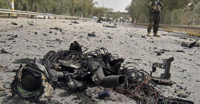 Car bombs in central Baghdad kill 9