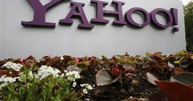 Yahoo 1Q results top analyst views; stock climbs