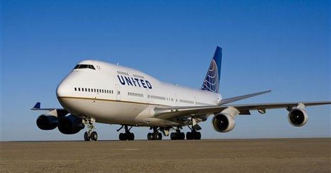 United Continental reports $213 million 1Q loss