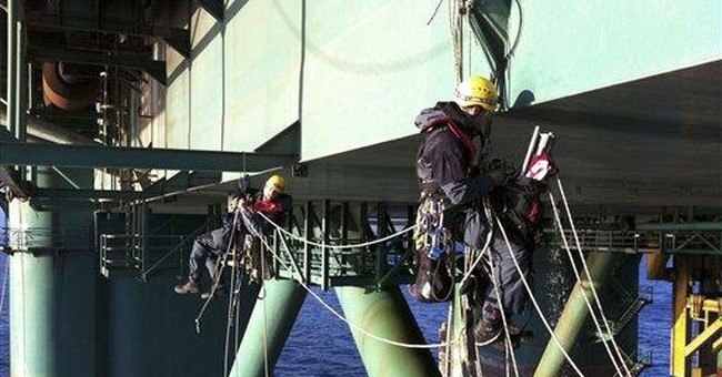 Activists abandon oil rig after drilling protest