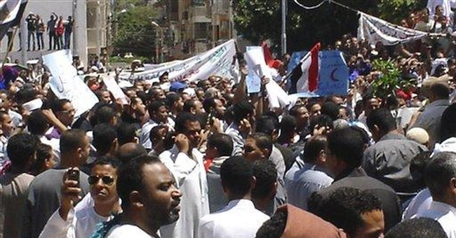 Crowds protest Christian governor in south Egypt