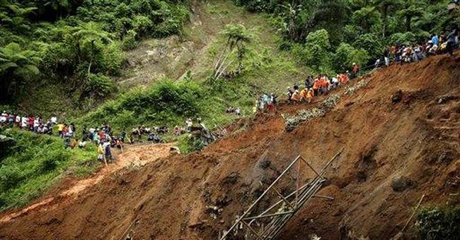 Hopes fade for 21 buried in Philippine landslide