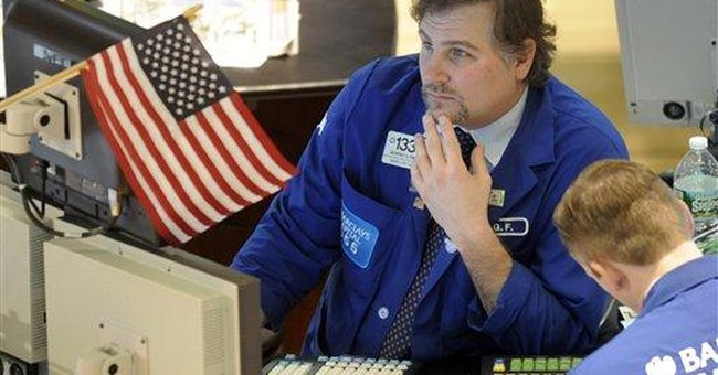 Mixed earnings reports weigh on stocks