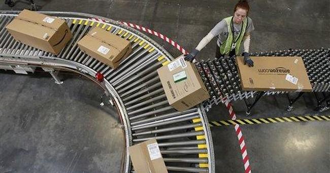 Amazon.com's profit tumbles more than expected