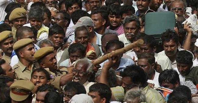 Tearful devotees gather for Hindu guru's funeral