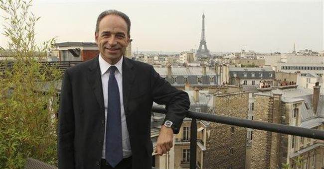 Sarkozy party chief: France can't afford migrants