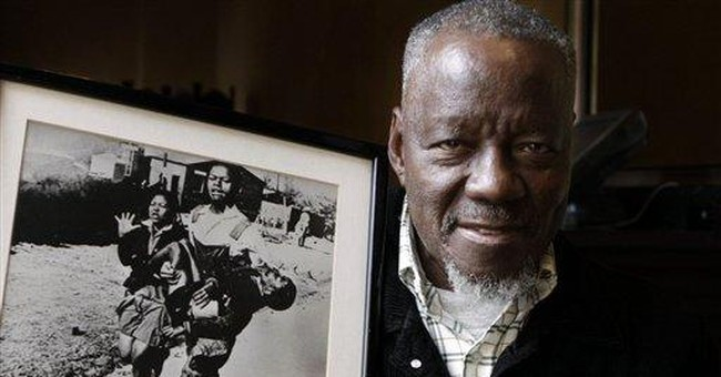 South Africa photographer honored for Soweto photo