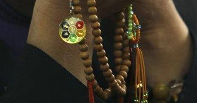 Dalai Lama prays for tsunami victims in Japan