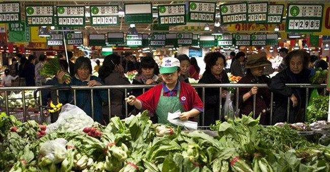 Beijing turns to currency to cool inflation
