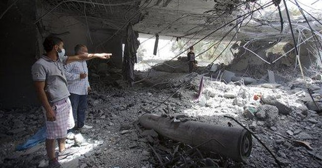 NATO on defensive over strikes close to Gadhafi
