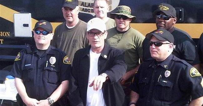 Charlie Sheen tours tornado damage in Alabama