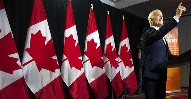 PM says he won't move Canada hard to the right