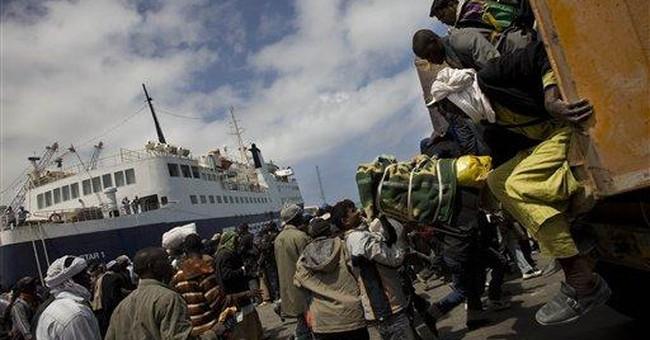 Libyan govt shelling kills 4 as aid ship docks