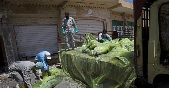 Men search shattered Libyan city for unburied dead