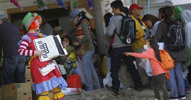 Superheroes cheer children in Japan's tsunami zone