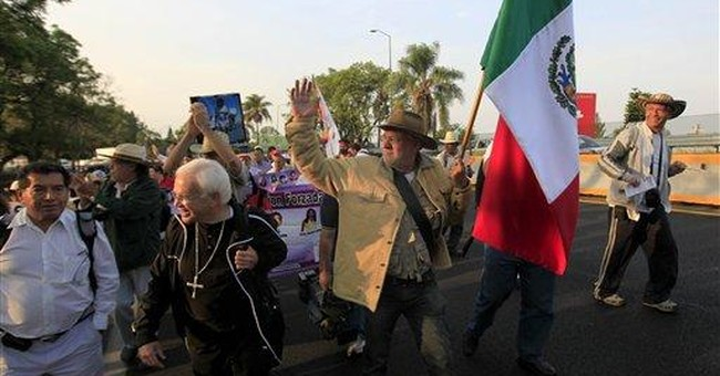 Hundreds march to Mexico City to protest violence