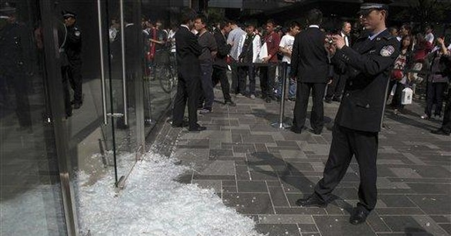 Scuffle at Apple store phone launch in Beijing