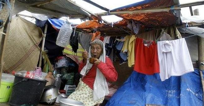 Philippine storm kills 17 people, threatens north