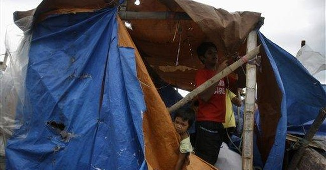 Philippine storm kills 11 people, threatens north