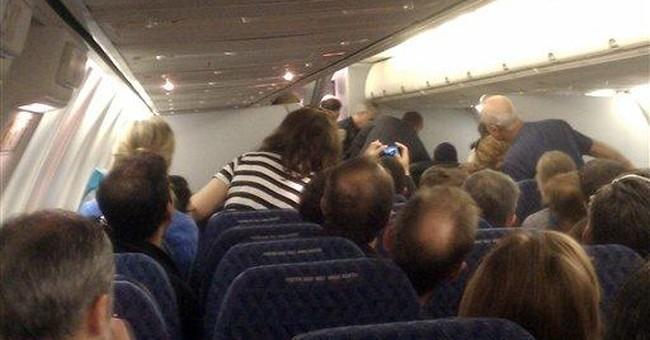 Suspect in flight disturbance had California ID