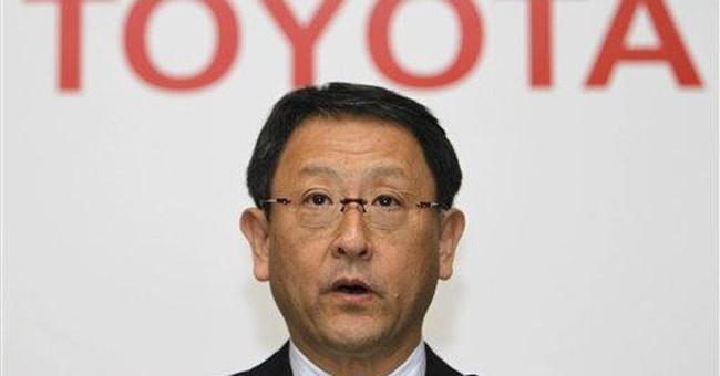 Toyota quarterly profit slides on quake disruption